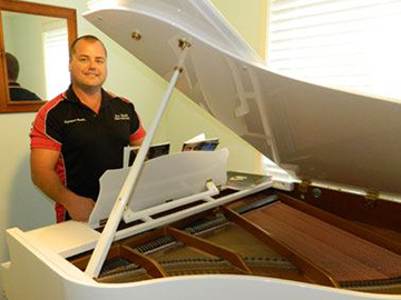 Setting up a baby grand piano